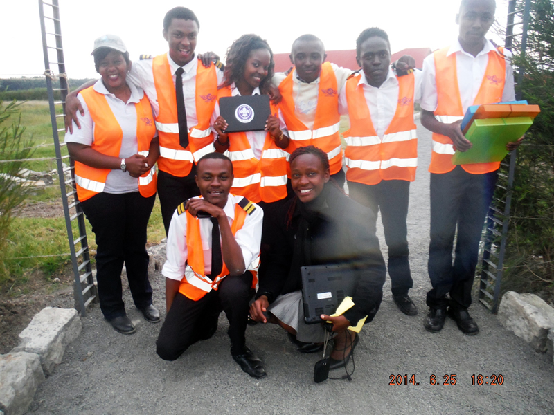 Young Aviators Club of Africa mentors with teacher Rosemary