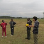 Duke University USA volunteer Abhisheik Upadhyaya learns about soccer from BSK students