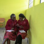 Beverly School of Kenya Students working with E-Reader - Kindle Tablet